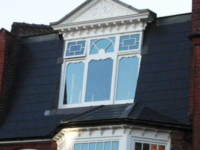 fancy window in mansard roof